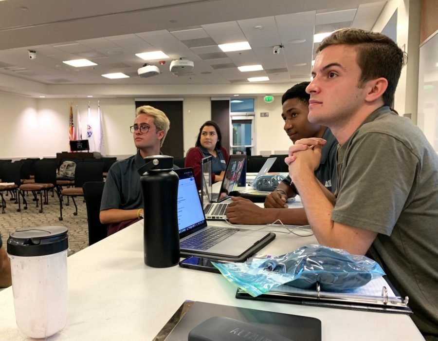 Discussing the upcoming semester: From left to right, Garrett Wyatt, Maria Reyes, Josh Gatison and David Bryant at the ASCLUG Senate meeting last Monday. Voting for Senate elections opens at 8 a.m. on September 19. Students can vote on the Spine or on Blackboard