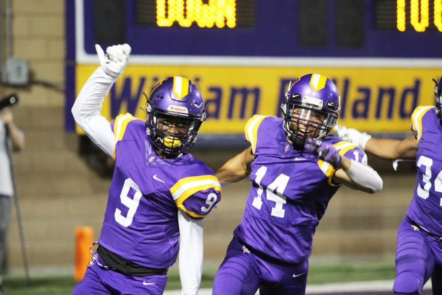 First-year wide receiver Cameron Jones and senior wide receiver Marcellous Lewis celebrate after scoring a touchdown against Pacific University of Oregon on Saturday, Sept. 21.
