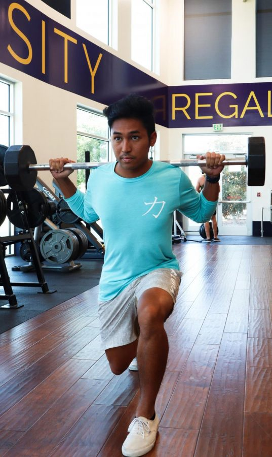 Landon+Navarro%2C+21%2C+does+a+lunge+in+a+shirt+from+his+own+clothing+line+called+RUSH.+Navarro+said+his+clothing+line+is+inspired+by+his+Hawaiian+heritage.+