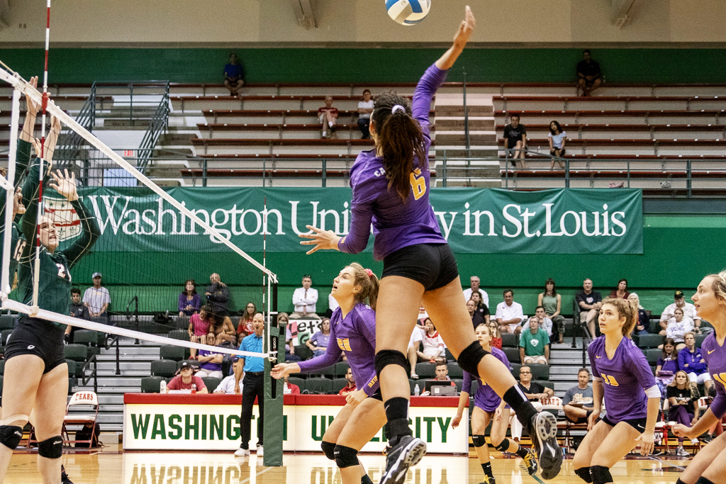 Mackenzie Martinez, junior opposite hitter, spikes the ball while playing in the East to West Battle tournament.
