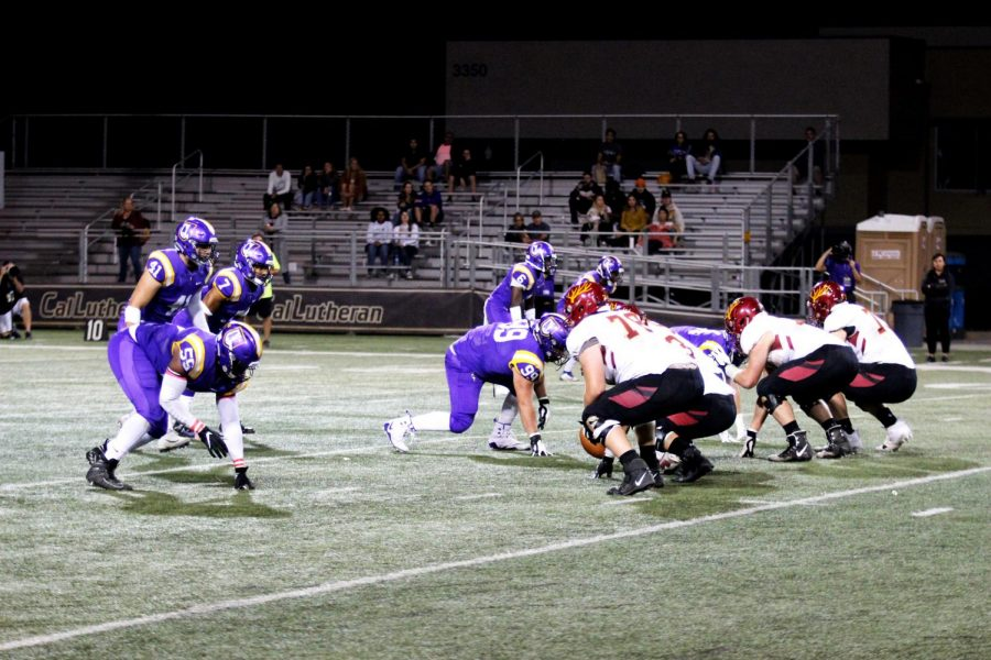 The Kingsmen defensive line get ready to rush the CMS offense during the homecoming game on Saturday, Oct. 12.