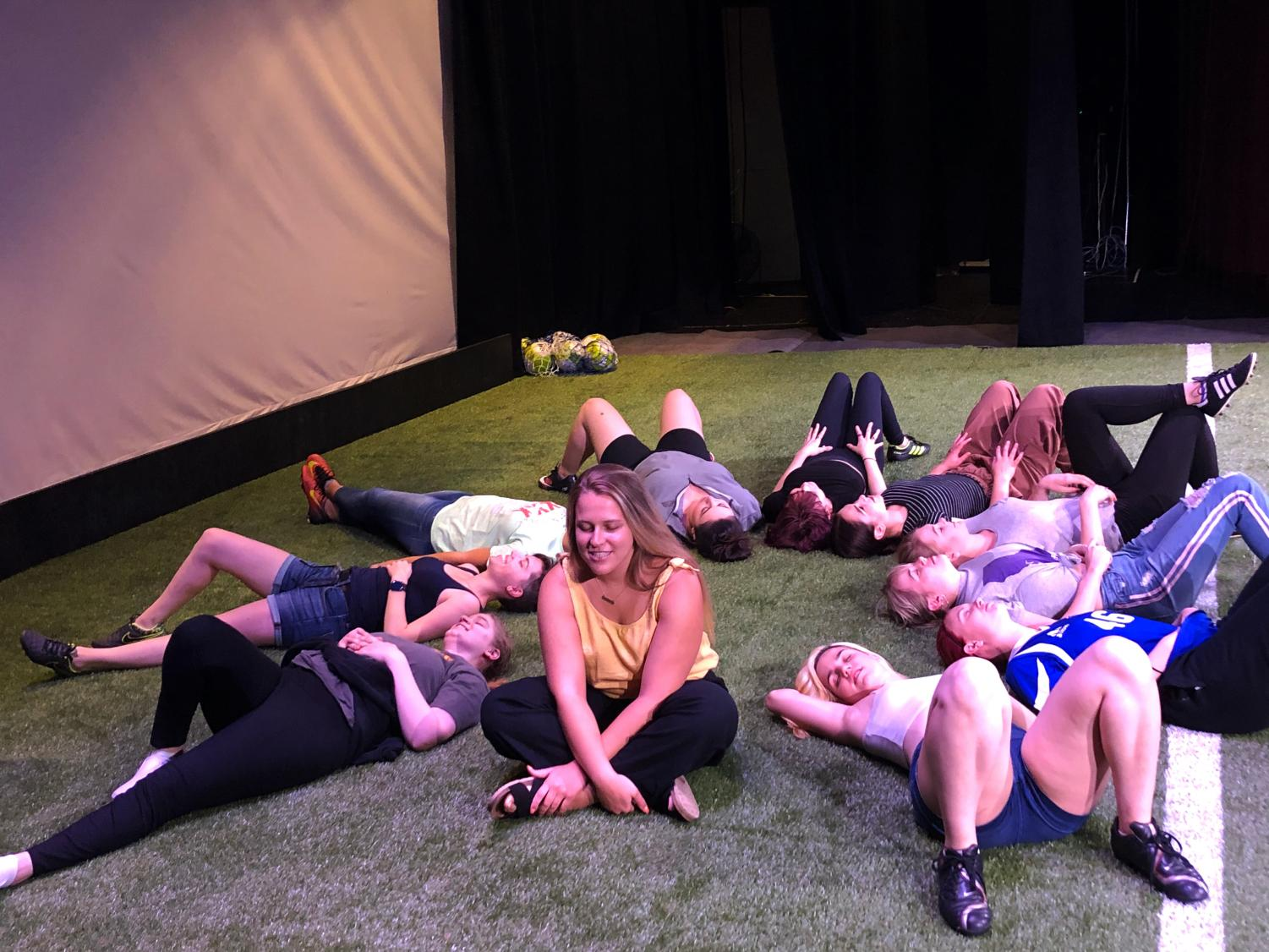 "The all female cast got their soccer on during rehearsal for the student led production ""The Wolves."" For this play, the Preus-Brandt Forum stage was covered with turf."