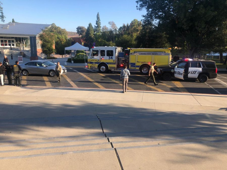 Emergency vehicles respond after a student was hit in the crosswalk between Ullman Commons and the Spine.