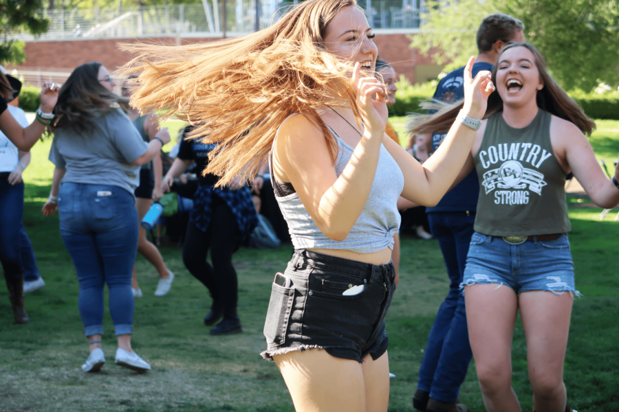 Country Strong: Senior Lauren Garrett, a Borderline survivor (right), and another student line dancing in Kingsmen Park on Friday, Nov. 8.