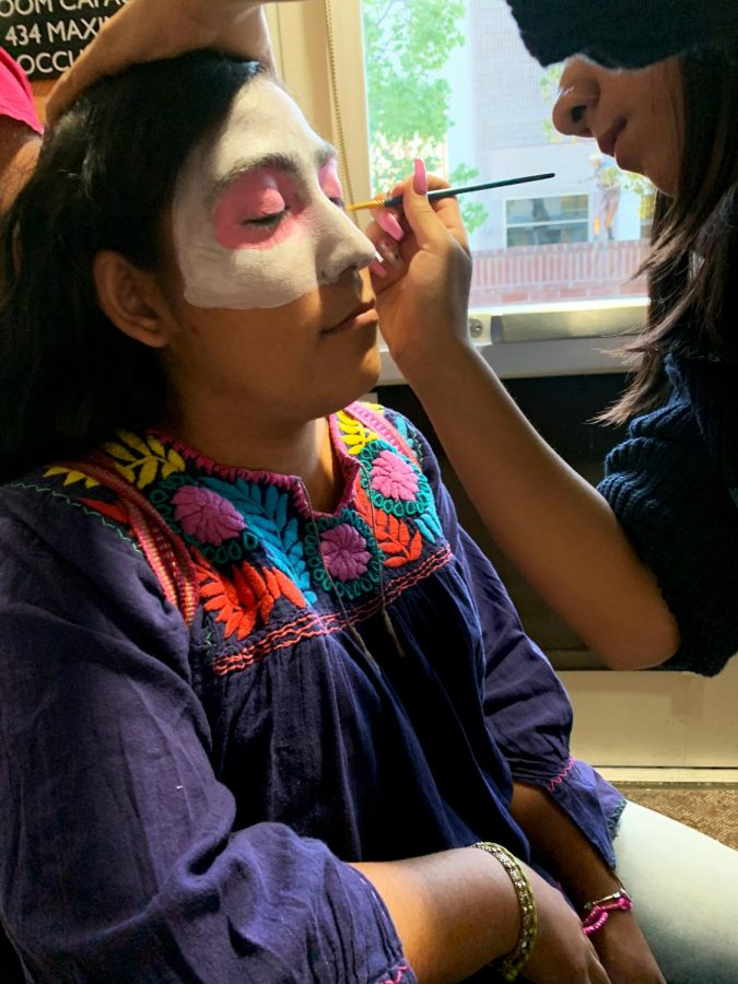 Abigail+Espinoza+Alfaro%2C+publicist+for+the+Latin+American+Student+Organization%2C+having+her+face+painted+at+the+event.