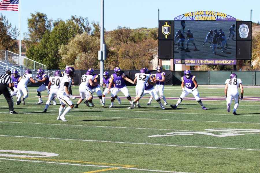 Senior+quarterback+Cesar+De+Leon+looks+for+an+open+receiver+against+the+Whittier+Poets%E2%80%99+defense+on+Saturday%2C+Nov.+16.