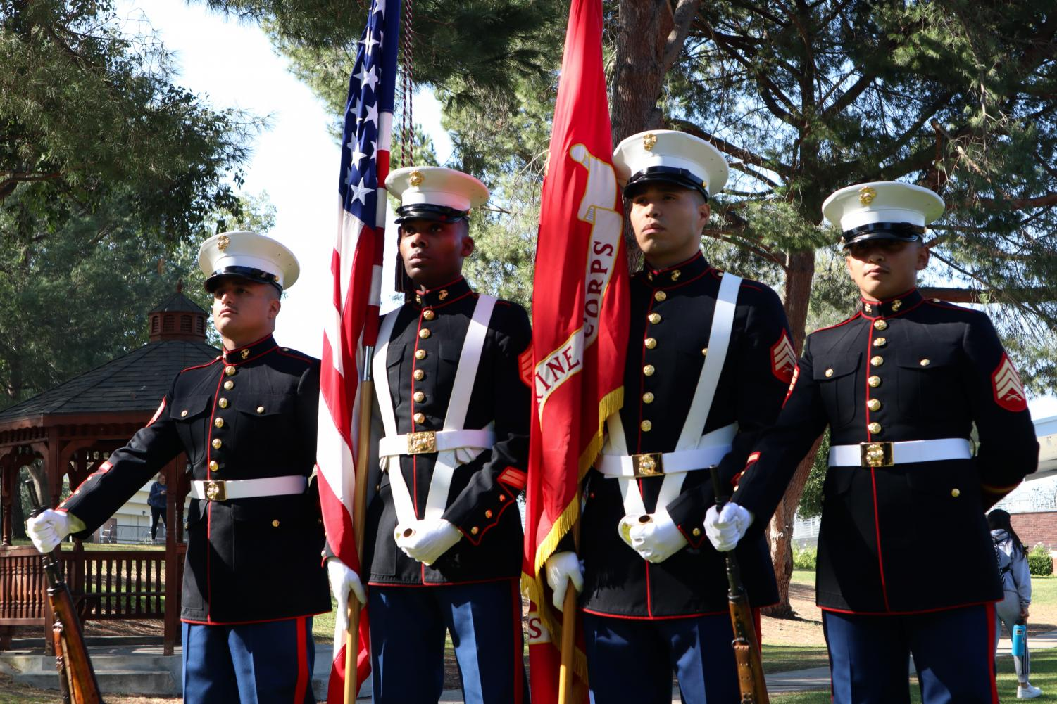 Sgt. Davila Rogger, Staff Sgt. Stephen Miller, Sgt. Francisco Gama, Sgt. Loya Alvin of the Color Guard Weapons Company prepare to march for the National Anthem during a veteran's celebration at California Lutheran University.