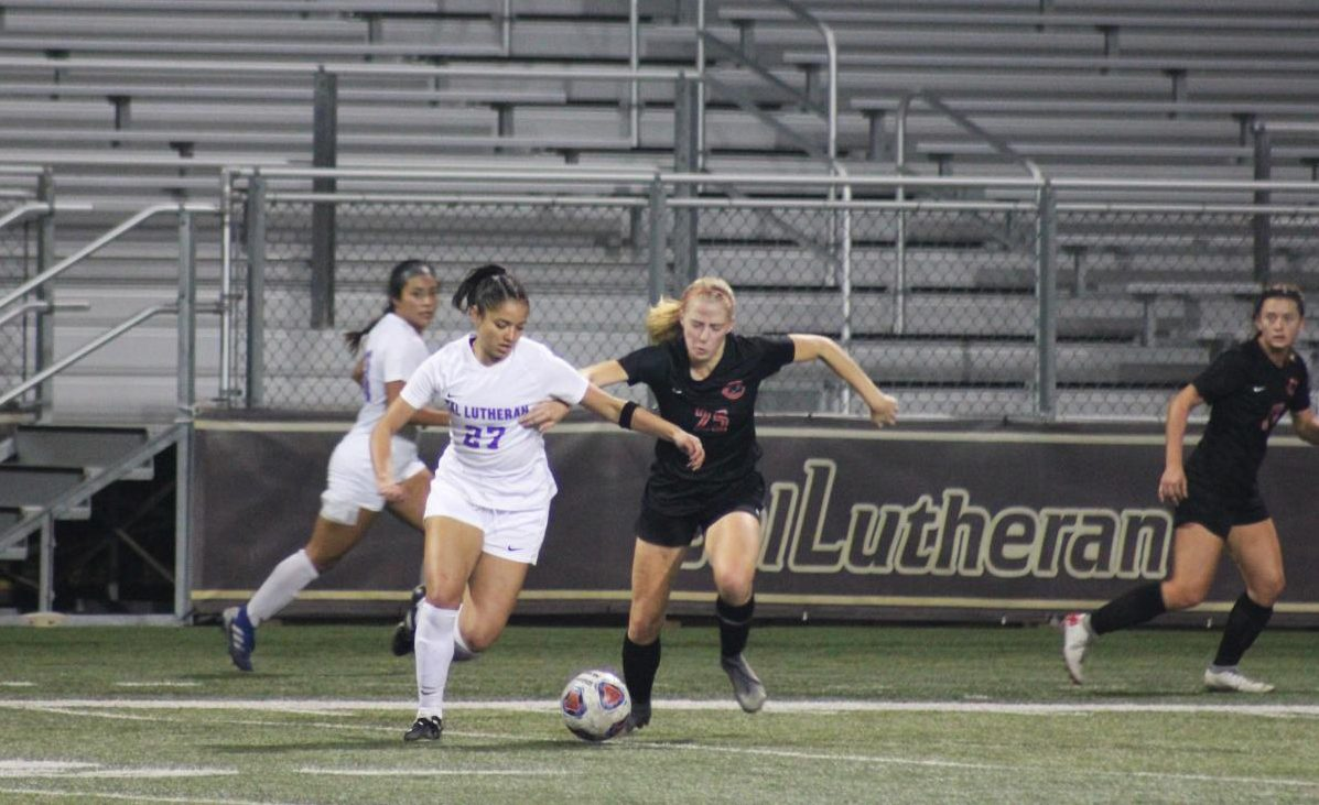 First-year forward Isabella Veljacic goes after the ball against Chapman senior defender Faith Holloway during the SCIAC semifinal game on Thursday, Nov. 7.