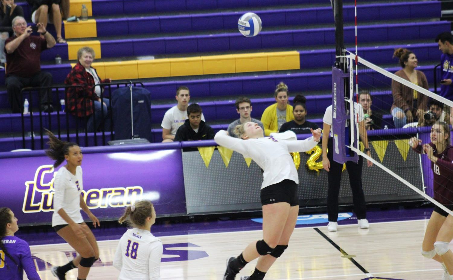 Sophomore middle blocker Maci Haddad jumps to hit a spike on Saturday, Nov. 2 while playing the Redlands Bulldogs.