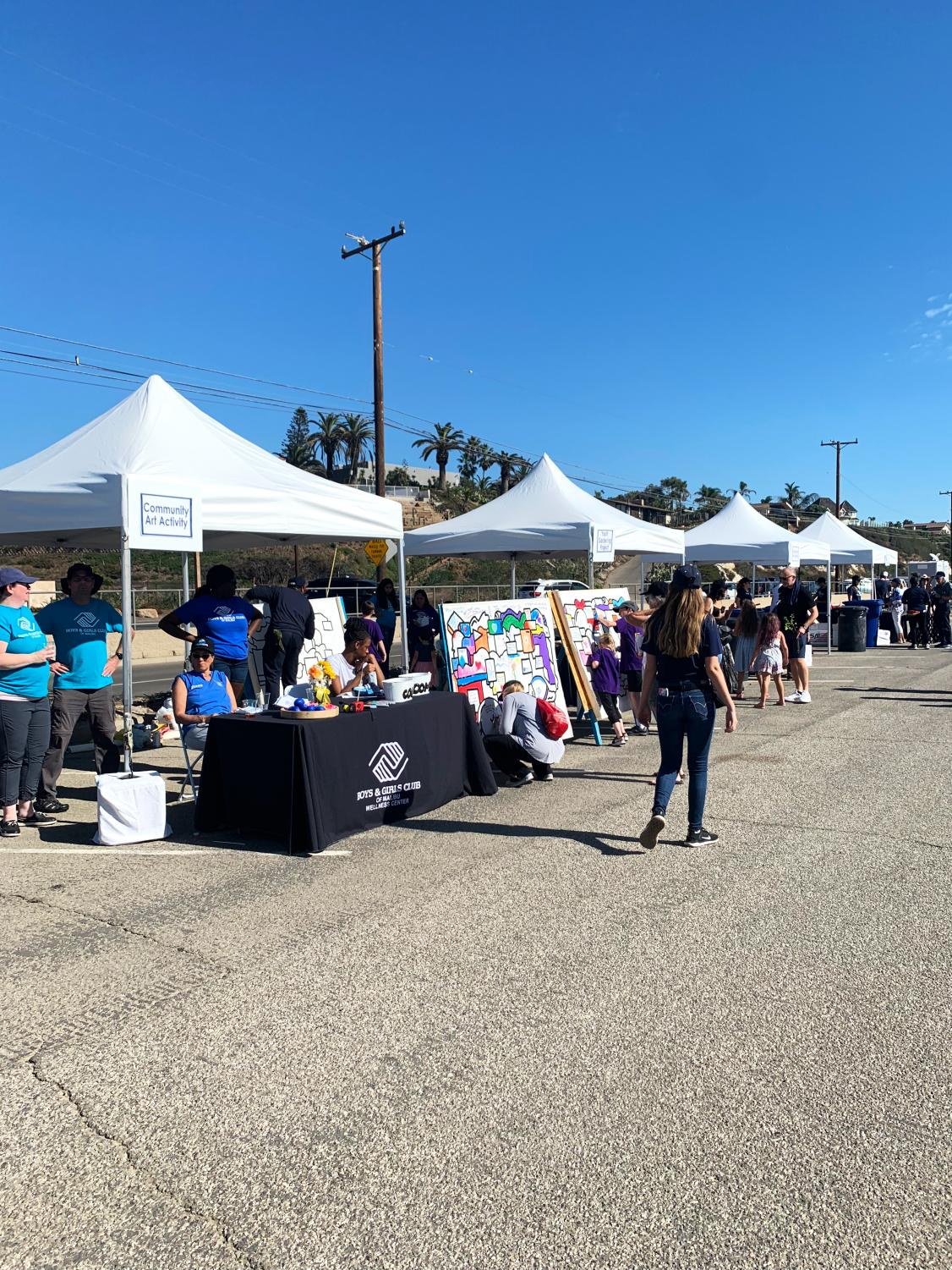 One year since Woolsey: Local organizations set up booths by Zuma Beach in Malibu to recognize the anniversary of the Woolsey Fire.