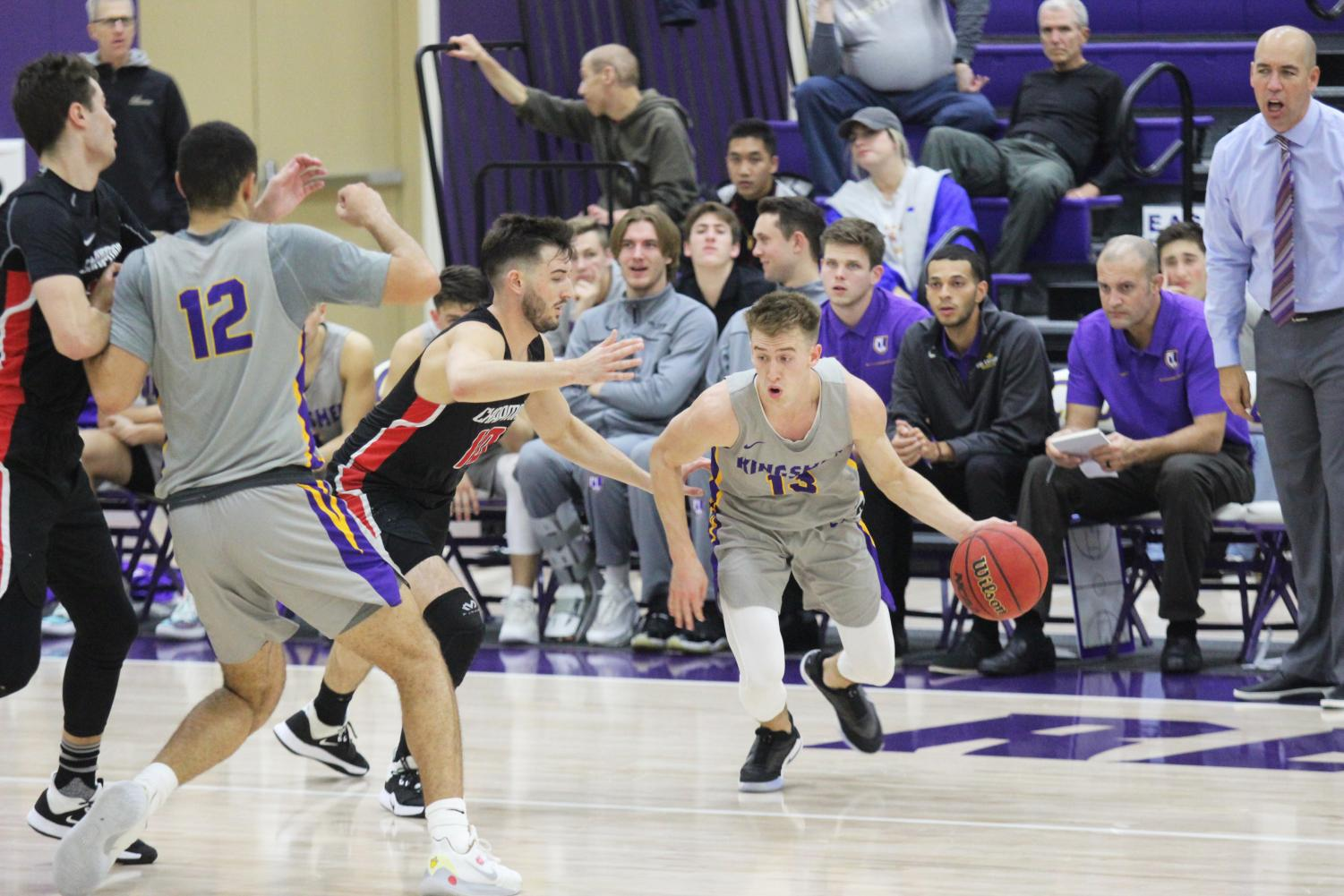 First-year forward Miles Houston attempts to get open as senior guard Palmer Chaplin dribbles the ball around Chapman shooting guard Colin Ferrier.