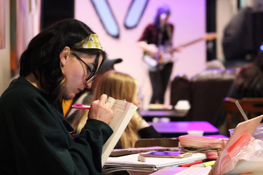 Gretchen Freihon, studying during open mic night at Five07, said she doesn't mind the music while doing her work and actually enjoys the background noise.