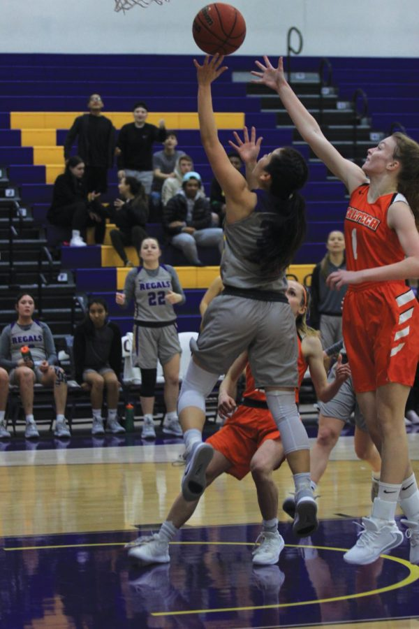 Sophomore guard Mackenzy Iwashi drives at the basket to help the Regals lead over Cal Tech.