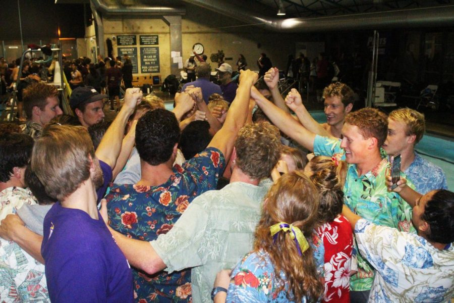The team, decked out in their Hawaiian shirts, gets in one last cheer at the end of the 4-day SCIAC Championships.