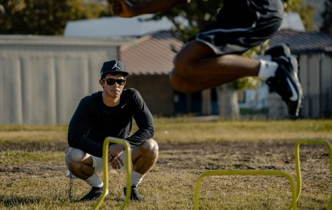 Cal Lutheran Strength and Conditioning Assistant Coach Lucas Quinn trains student-athletes outside at a park in Thousand Oaks, CA.