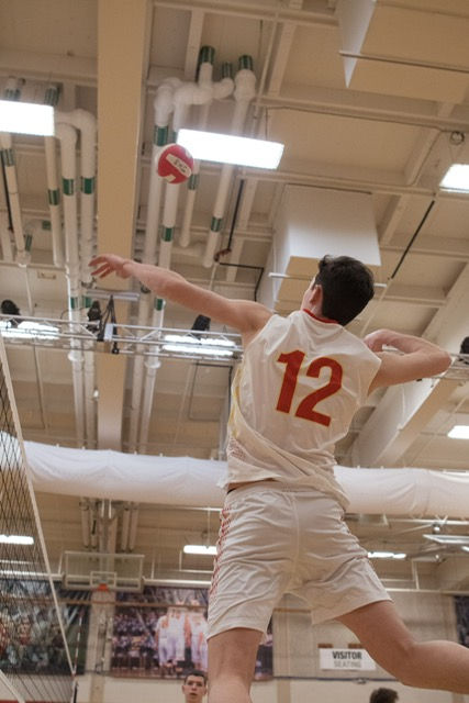 High school senior Logan Marks jumps to hit on the opposing side while playing for the Northern California Volleyball Club's 18U team.