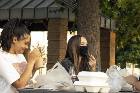 From left: Freshman roomates Naja Butler and Coral Fay enjoy takeout in the Pederson/Thompson courtyard Sept.15. This year, Residence Life implemented stricter policies pertaining to visitors and guests.