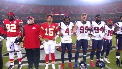 The Kansas City Chiefs lock arms in solidarity.