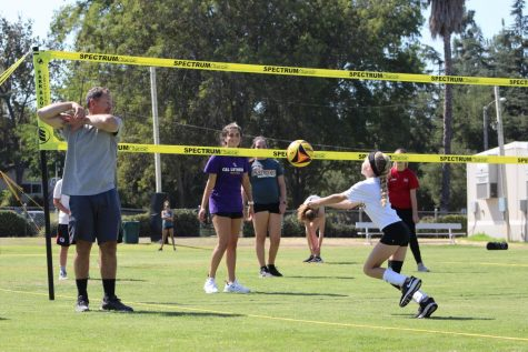 Regals Volleyball coaching kids to increase their skills and bring community.