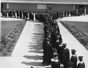 California Lutheran University holds its first commencement in May 1964.