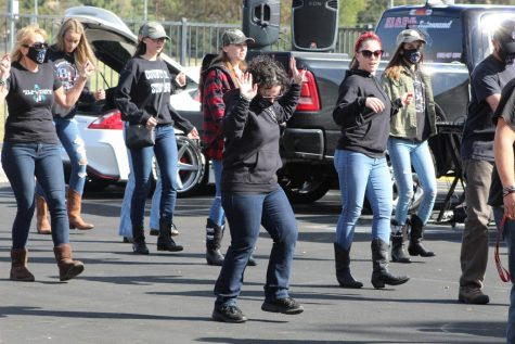 Community members start an impromptu line dance during the Borderline Remembrance Drive.