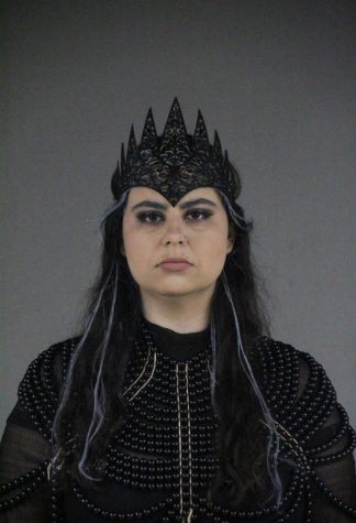 Julia Weiss dressed in full costume for her role as Queen Lear. She originally auditioned for the male role of King Lear, but director Michael Ardnt decided a Queen Lear would be more fitting.