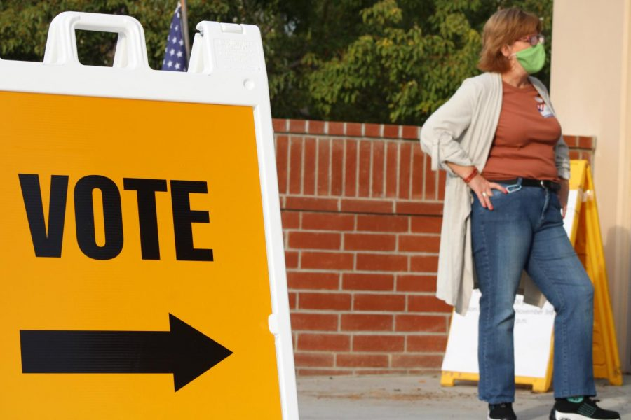 A Ventura County Clerk-Recorder Poll Worker stands outside the in-person voting location at California Lutheran University Nov. 3.