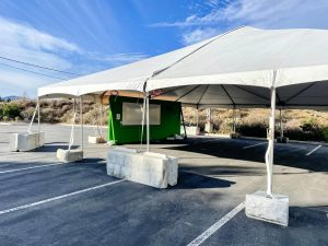 Professors had the opportunity to opt-out of in-person learning while Ventura County remains in the purple, or most restrictive tier under Gov. Gavin Newsom's reopening guidelines. When the state moves into the red tier, however, professors that do not have health exceptions will be required to teach in person.   Pictured: an empty outdoor tent is constructed for in-person outdoor classes.