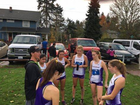 Cal Lutheran alumnus, Track and Field and Cross Country Assistant Coach Brett Halvaks talks to the Regals after a race.