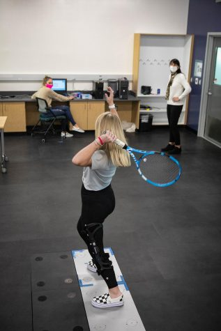 Students conducting practical research in EXSC 301L: Biomechanics Lab.