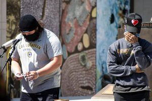 Kingsmen Football players Thomas Bambrick and Cameron Jones share memories of former teammate and friend Chris Leveque at a vigil held at the end of March.