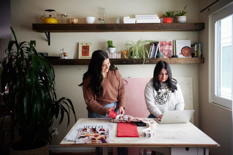 Owners of Girlside Boutique Sofia Mikaeili and Mary Maryouhana pack orders.