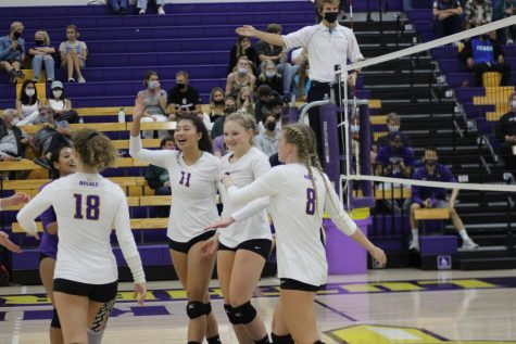 The Regals celebrate after scoring a point against Occidental (Photo by Karly Kiefer-Reporter)