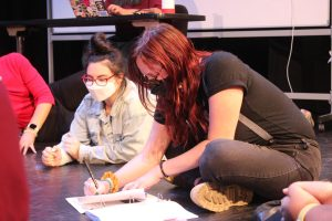 Student Jules Weiss sits beside Intimacy Director Carly Weckstein as the cast creates an ensemble agreement.