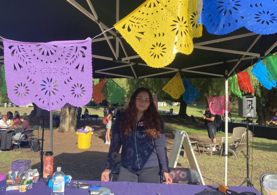Junior Araceli Curiel represents the Center for Cultural Engagement & Inclusion booth at the Latinx Heritage Fiesta.